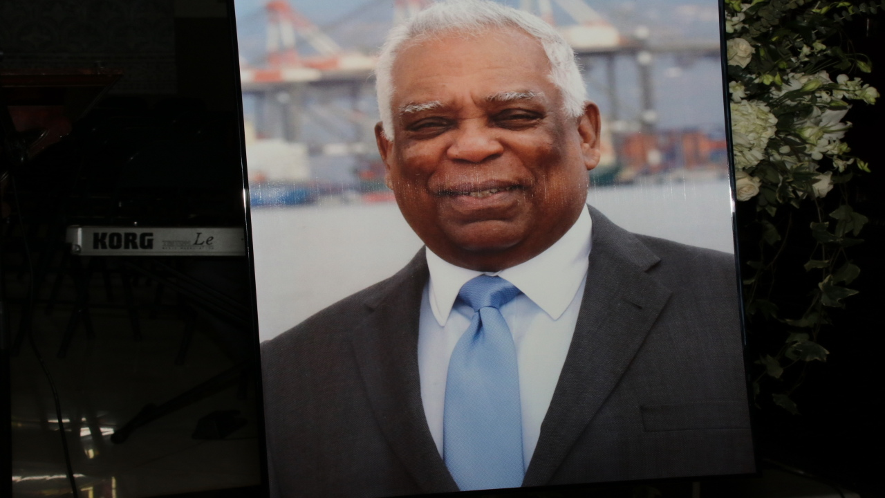A snapshot of a photo on display of the recently-departed Port Authority of Jamaica (PAJ) giant, Noel Hylton, at a service of thanksgiving for his life in Kingston on Saturday. (Llewellyn Wynter photos)