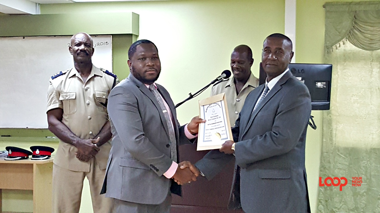 Carl Cummins (left) was named the Most Outstanding participant amongst the participant. (right) Acting Assistant Commissioner of Police responsible for crime, Colvin Bishop