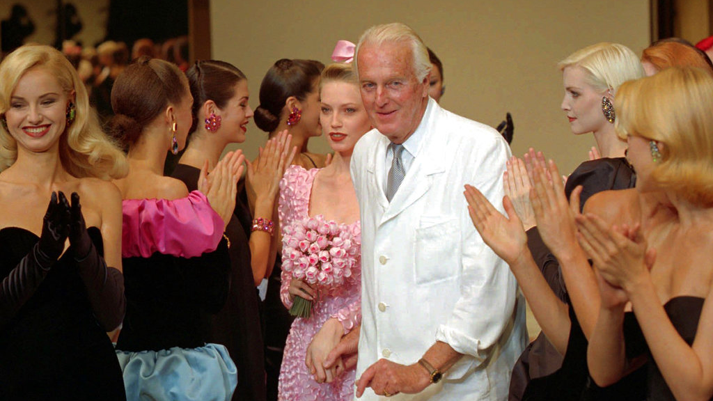 In this July 11, 1995 file photo, French designer Hubert de Givenchy is applauded by his models after his 1995-96 fall-winter haute couture fashion collection in Paris.