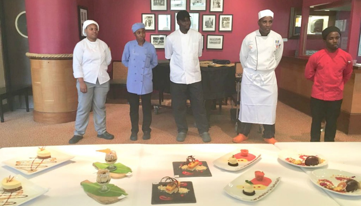 Some of the competitors in the BHTA's 2018 Barbados Culinary Competition as they present their dishes to the judges.