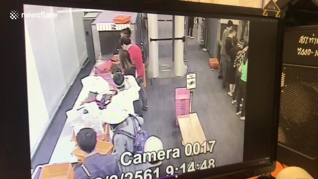 Watch: Airport guard caught on CCTV stealing cash from
