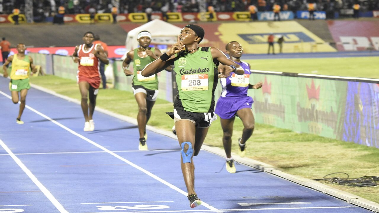 Kevroy Venson of Calabar High celebrates at the wire after a stunning victory over  KC's Ugandan athlete Arymanya Rodgers in the Boys' 5000m open on March 24 at the  Boys and Girls' Athletics Championships, at the National Stadium. Venson will be in action for Jamaica in the Boys' U20 1500m final on Saturday at the Carifta Games in The Bahamas. (PHOTO: Marlon Reid).