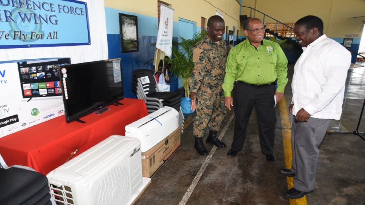 National Security Minister, Robert Montague (right), along with Chief Executive Officer of the Passport, Immigration and Citizenship Agency (PICA), Andrew Wynter (centre), and Acting Commander of the Jamaica Defence Force (JDF) Air Wing, Major Anthony Gregory, share in the presentation of a number of appliances to the air wing at Up Park Camp last Friday.