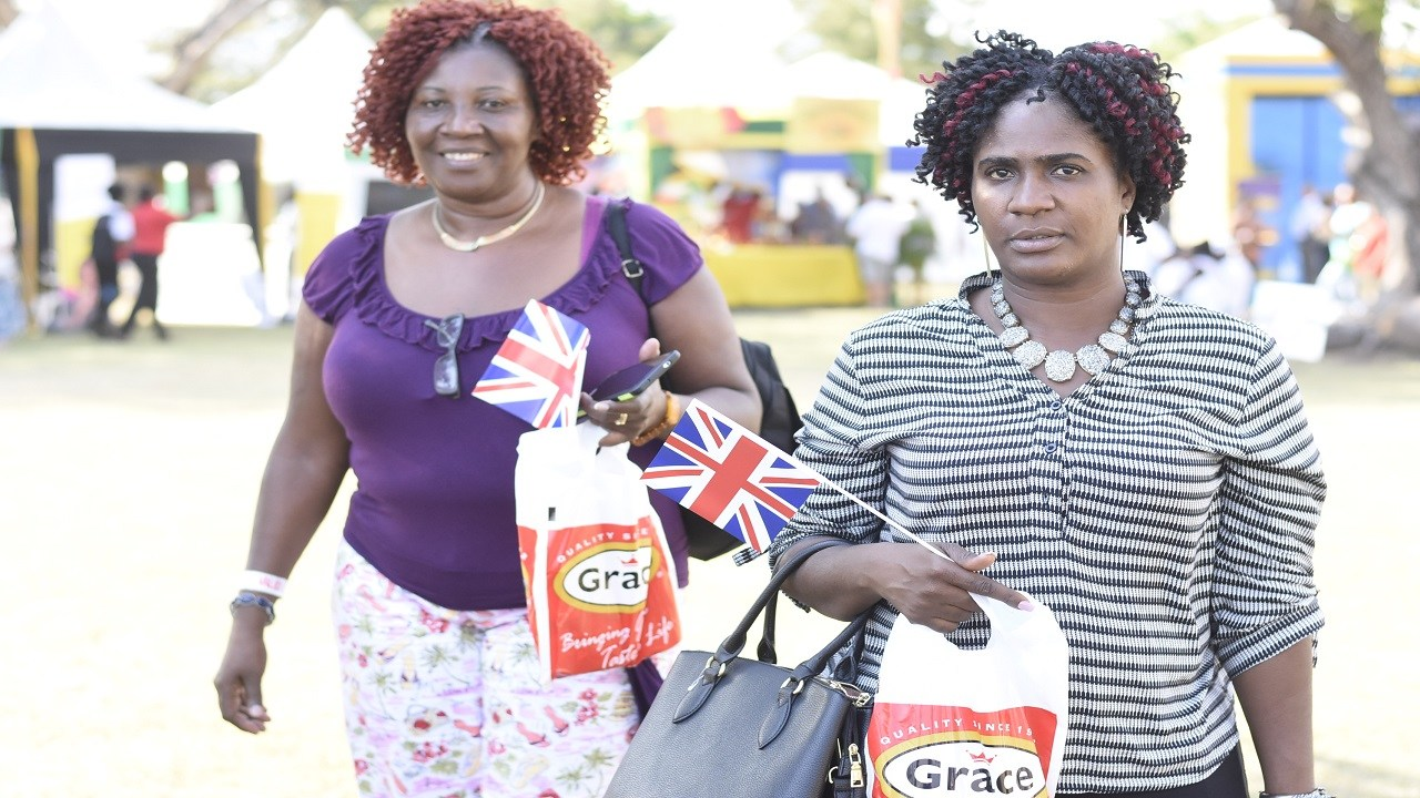 Patrons carry GraceKennedy bags at the UK/Jamaica trade fair on Saturday, on the lawns of the British High Commission in St Andrew. (PHOTOS: Marlon Reid)