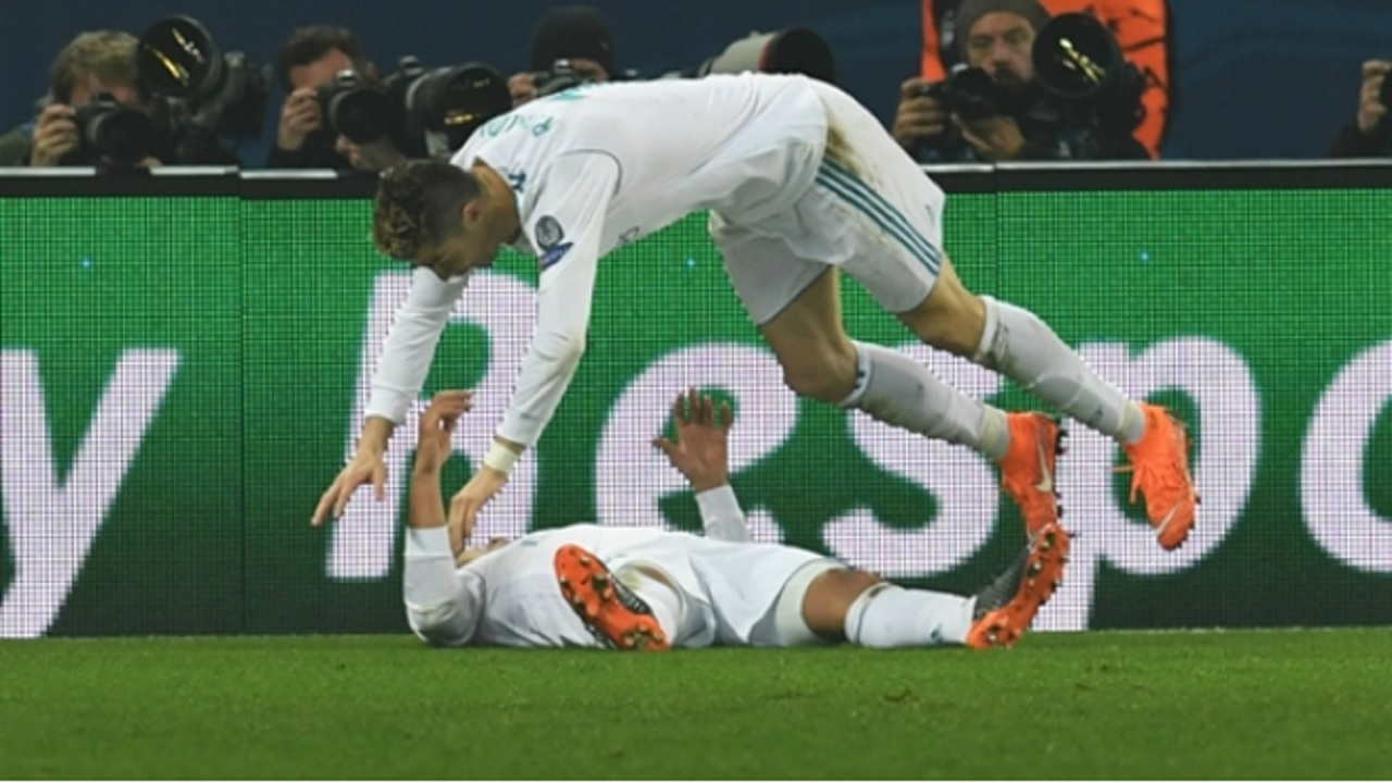 Cristiano Ronaldo and Casemiro celebrate against PSG.
