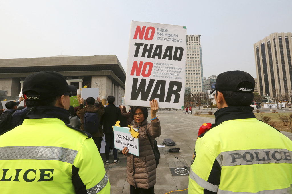 A protester holds up a banner during a rally demanding peace on the Korean Peninsula near U.S. Embassy in Seoul, South Korea. (AP Photo/Ahn Young-joon)
