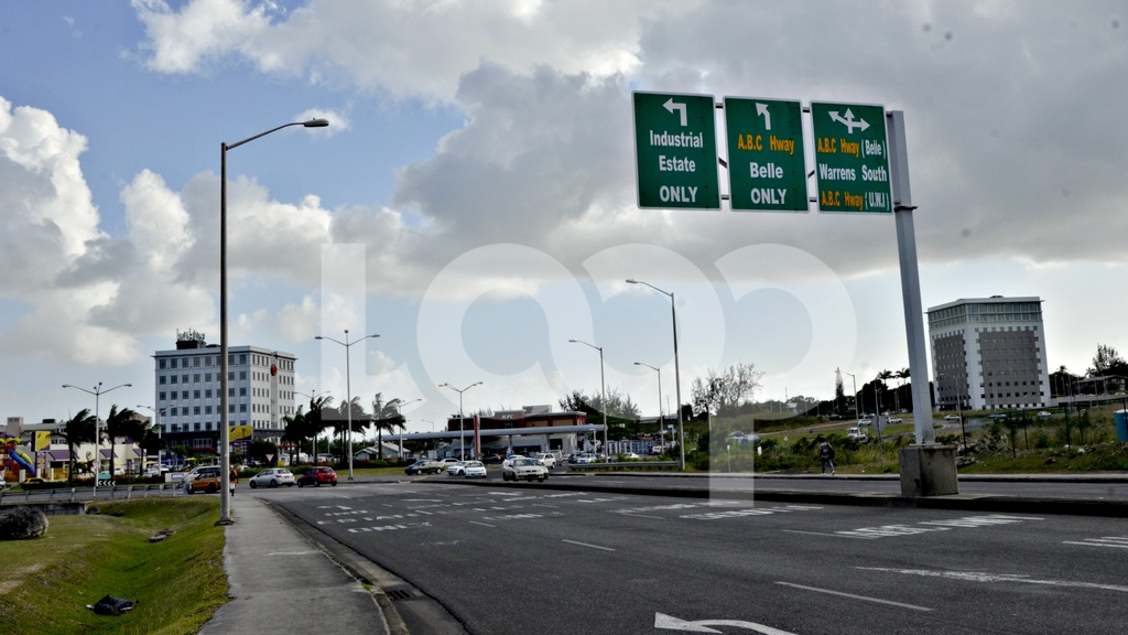 Vehicles maneuver around the D'Arcy Scott Roundabout in Warrens, St Michael.