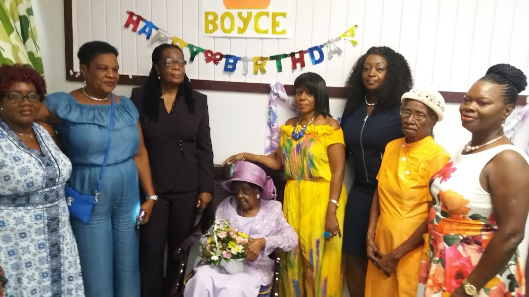 Governor-General Dame Sandra Mason, joined with family to wish Olga Augusta Boyce a happy 100th birthday, at the Geriatric Hospital last night.