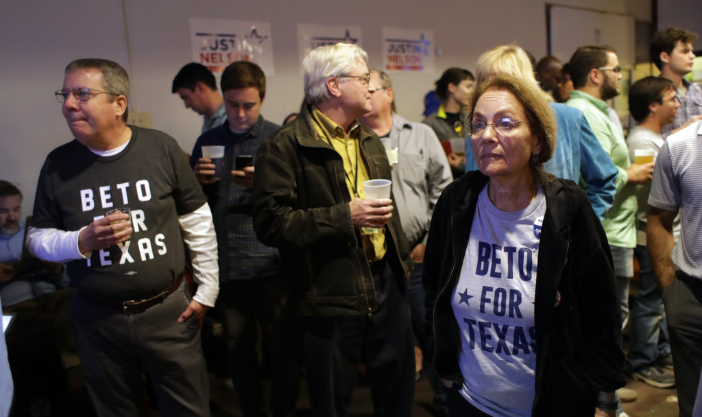 Supporters watch results on a screen during a Democratic watch party following the Texas primary election. (AP Photo/Eric Gay)