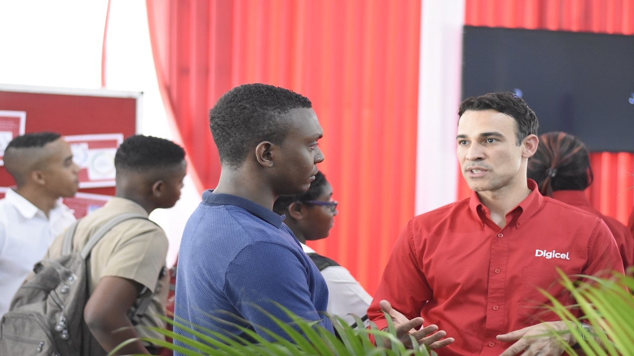 Digicel Jamaica CEO, Justin Morin (right) engages Daniel  Gordon in discussion at the Career Fair at the University of the West Indies Mona Campus last week. (PHOTOS: Marlon Reid)
