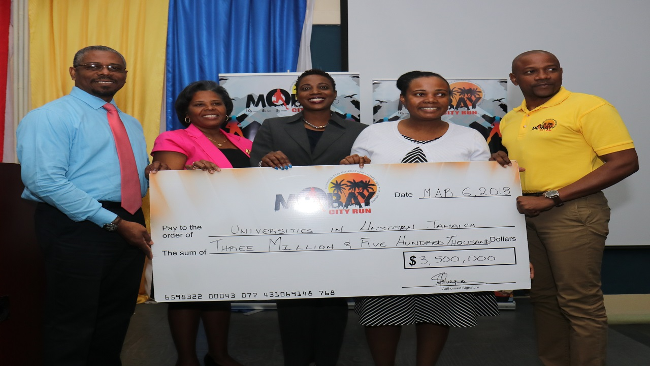 From left Acting Director, University of the West Indies, Western Jamaica Campus Patrick Prendergast, Sophia McIntosh of UTech Jamaica Western Campus, Vivette Fearon Hall of Montego Bay Community College, Nordia Seymour-Hall, director, Sector Support Services, Early Childhood Commission (ECC) and Conrad Allen of MoBay City Run committee pose during the cheque presentation.