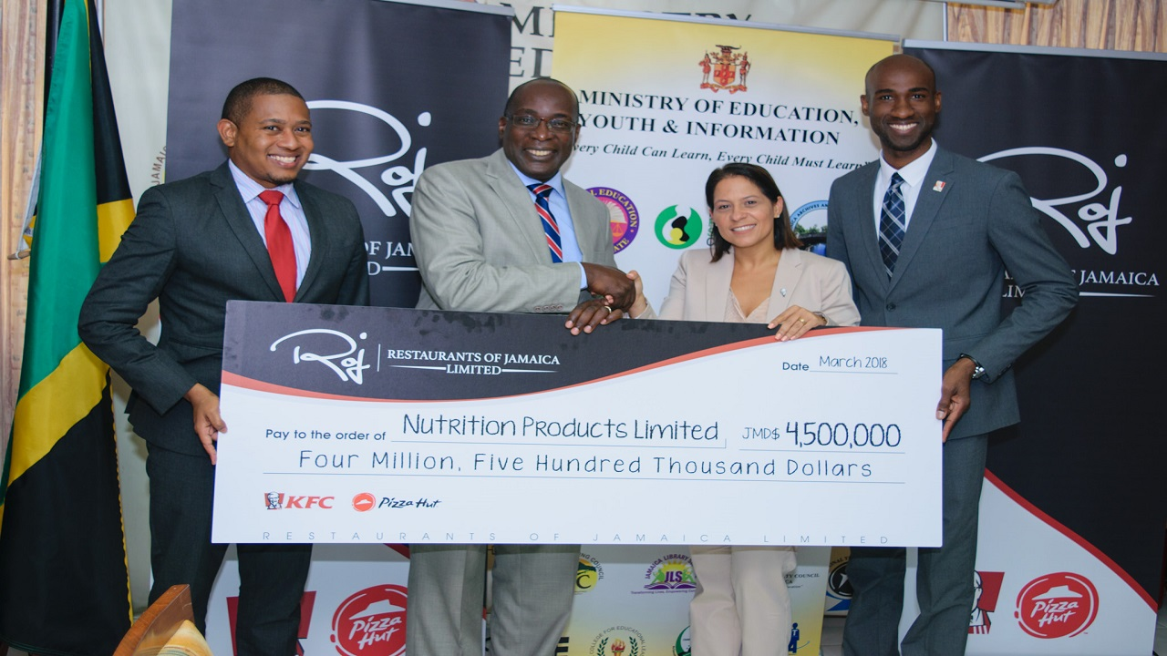 Left to right: Floyd Green, education state minister; Education Minister Ruel Reid; Tina Matalon, Marketing Director for Restaurants of Jamaica and Andrei Roper, Brand Manager at Restaurants of Jamaica.