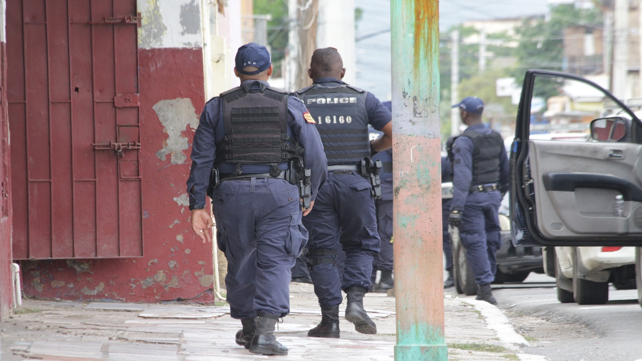 Police officers conduct an operation in West Kingston on Thursday. (PHOTOS: Marlon Reid)