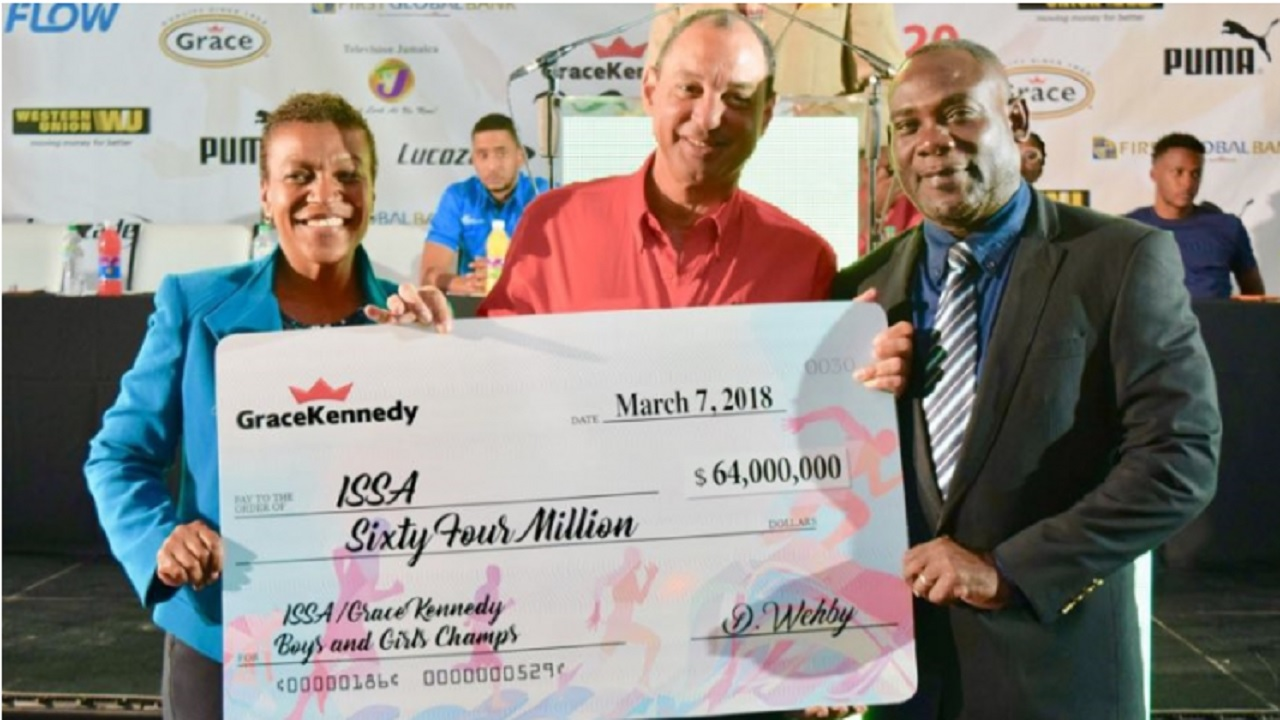 Colleen Montague (left), chairman of the Boys and Girls' Championships Organising Committee; Don Wehby (centre), Grace Kennedy Group CEO  and ISSA President Dr Walton Small  display the sponsorship cheque for the Boys and Girls' Athletic Championships during the official launch of the 2018 renewal at the Spanish Court Hotel on Wednesday.