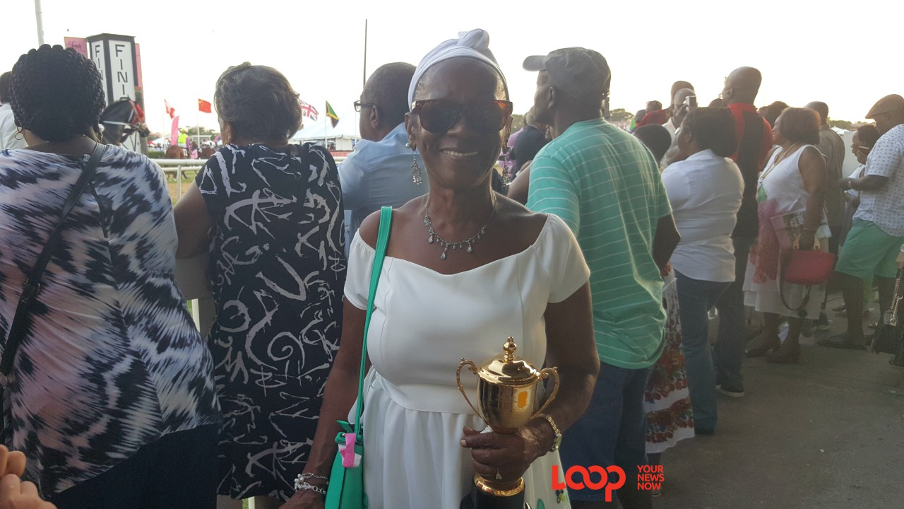 Maria Samuel, Jalon Samuel's grandmother with the smaller Gold Cup after his win.