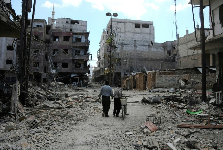 """35 personnes ont été tuées mardi dans un tir de roquette des rebelles qui a visé un """"marché"""" dans la banlieue de Damas."""
