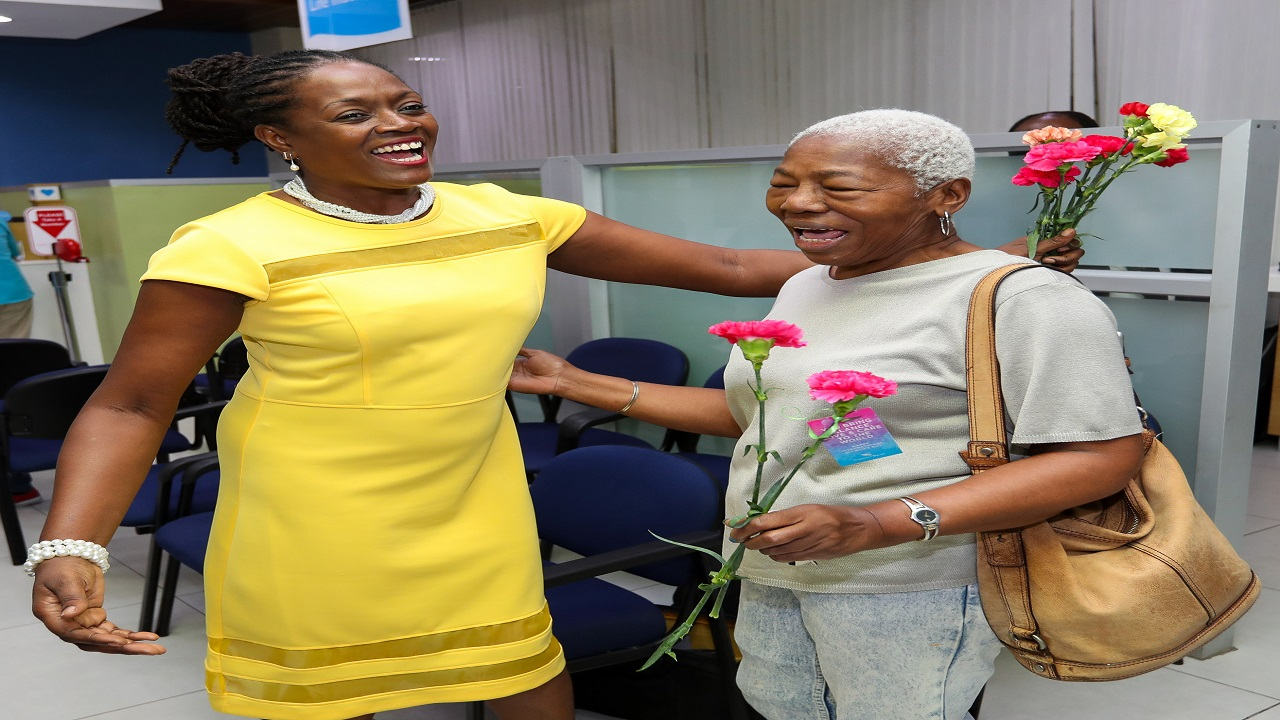 Chorvelle Johnson, CEO of Sagicor Bank greeted female customers at the head office.