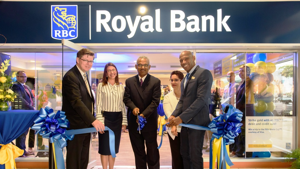 Rob Johnston, Head Caribbean Banking RBC; from left, Gretchen Camacho-Mohammed, Regional Operating Officer, RBC Royal Bank Trinidad and Tobago; MP for Couva South, Rudranath Indarsingh; Joanne Forde, Store Manager, RBC Royal Bank Trinidad and Tobago; and Darryl White, Managing Director, RBC Royal Bank Trinidad and Tobago, following the ribbon-cutting to mark the formal launch of RBC's Pt Lisas Financial Solutions Centre on February 27, 2018, at Atlantic Plaza, Pt. Lisas.