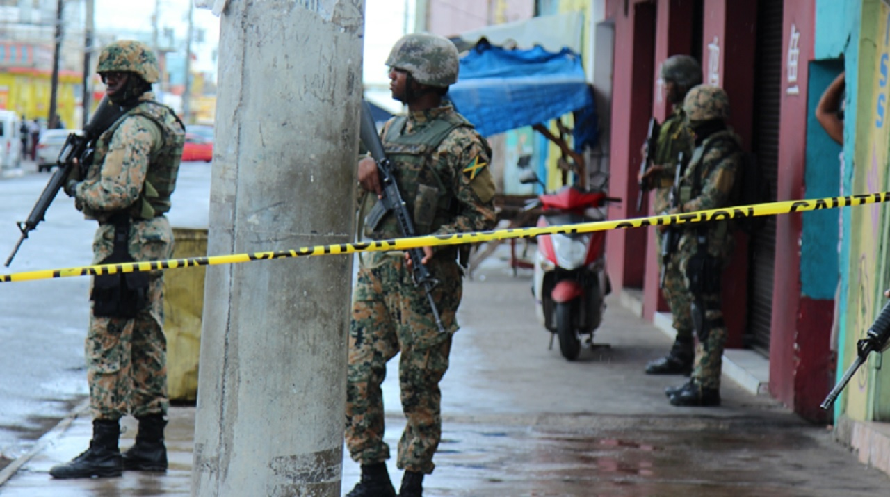 Jamaica Defence Force soldiers at a crime scene in Kingston. (PHOTO: FILE)