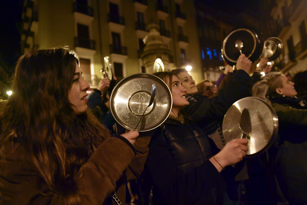 Demonstrators protest male violence against women and demand an equality labor opportunities during the general female strike to commemorate International Women's Day, in Pamplona, northern Spain. (AP Photo/Alvaro Barrientos)