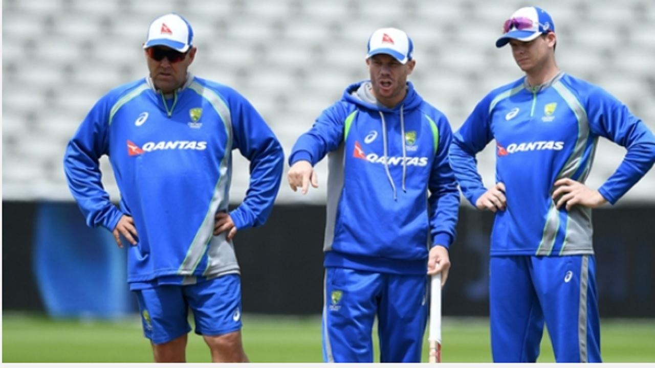 Steve Smith, David Warner and Darren Lehmann inspect the pitch at Edgbaston.