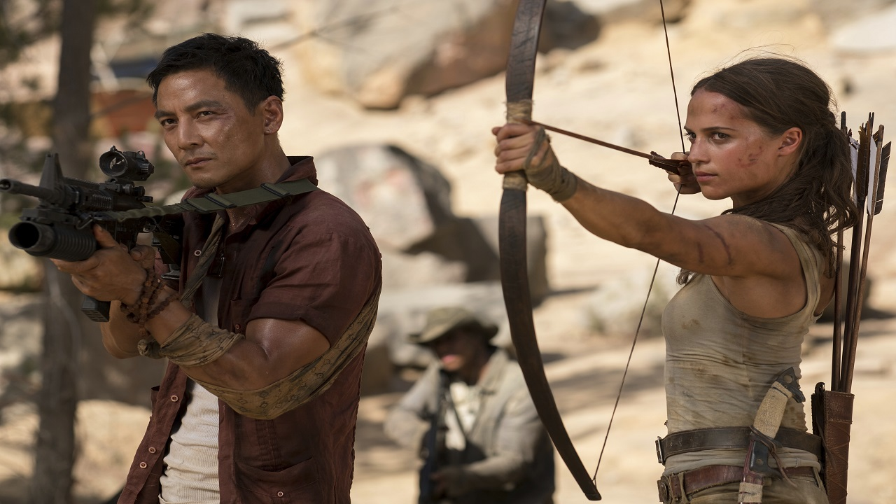 """This file image released by Warner Bros. Pictures shows Daniel Wu, left, and Alicia Vikander in a scene from """"Tomb Raider."""""""