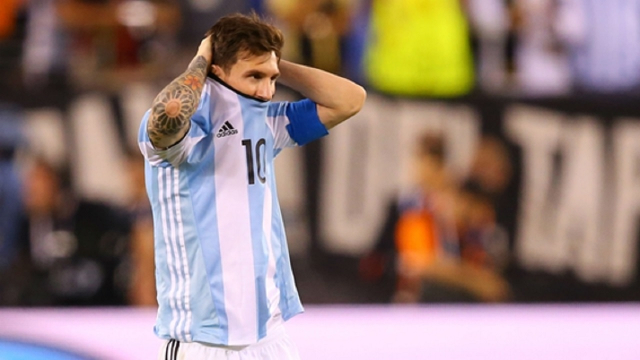 Argentina captain Lionel Messi holds his head.