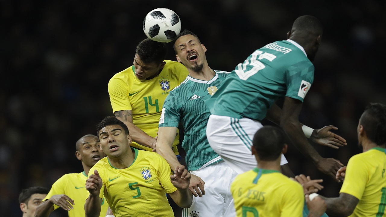 Germany's Sandro Wagner, center, is airborne with Brazil's Thiago Silva during the international friendly football match  in Berlin, Germany, Tuesday, March 27, 2018.