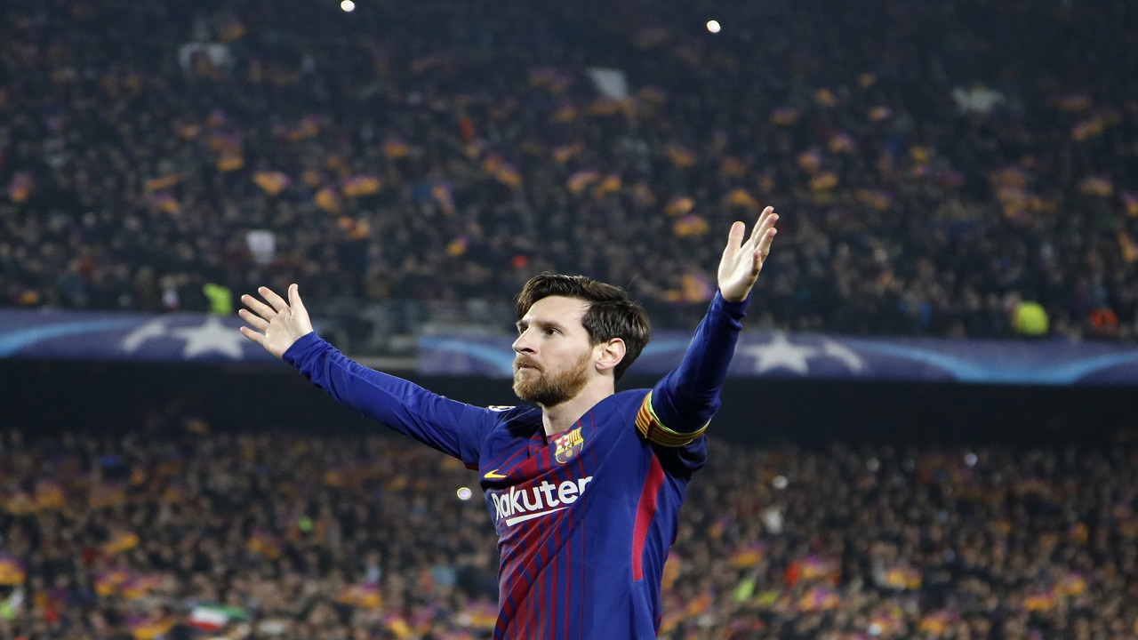 Barcelona's Lionel Messi celebrates after scoring his side's third goal during the Champions League round of sixteen second leg football match against Chelsea at the Camp Nou stadium in Barcelona, Spain, Wednesday, March 14, 2018.