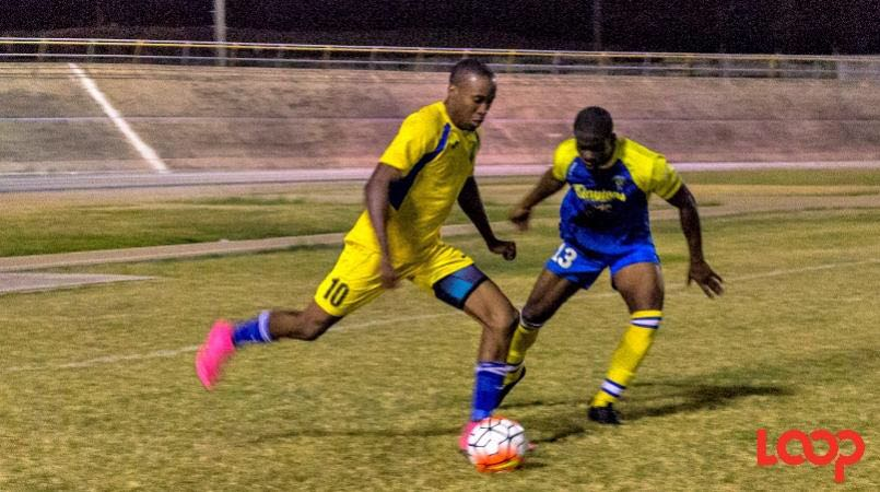 File photo of Armando Lashley of Paradise FC (left) taking on Keiron Cox of Notre Dame (blue). (File photo).