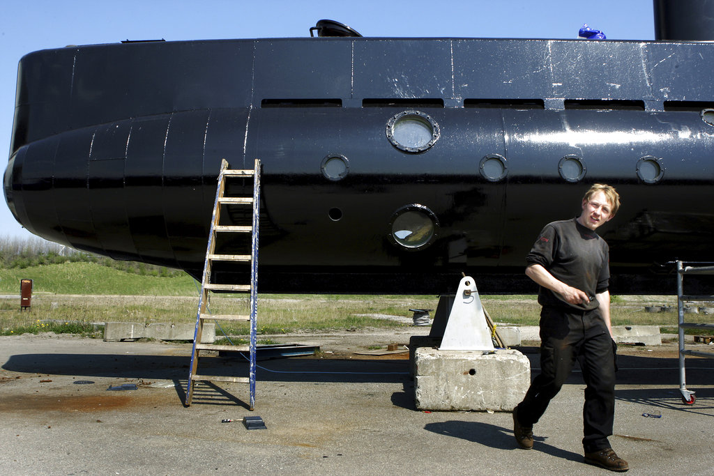 This file photo shows a submarine and its owner Peter Madsen. (Niels Hougaard/Ritzau via AP, File)