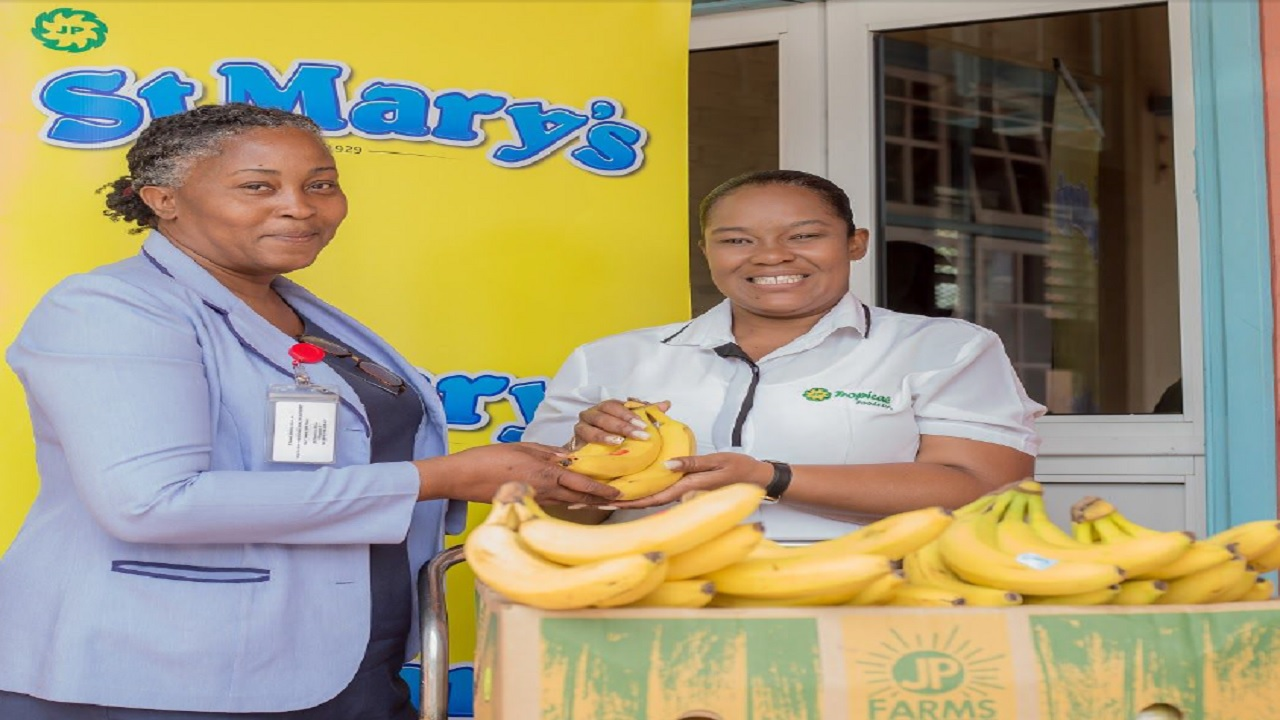 Karlene Taylor McKenzie (left), Administrator of the Bustamante Hospital for Children, receives the JP St. Mary's donation to the hospital from Carol Rodriques (right), Sponsorship and Promotions Coordinator, JP St. Mary's.