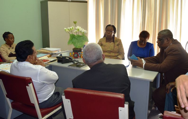 Education Minister Anthony Garcia and Chief Education Officer Harrilal Seecharan (back facing camera) in discussions with school supervisors from the Port-of-Spain and Environs Education District Office.