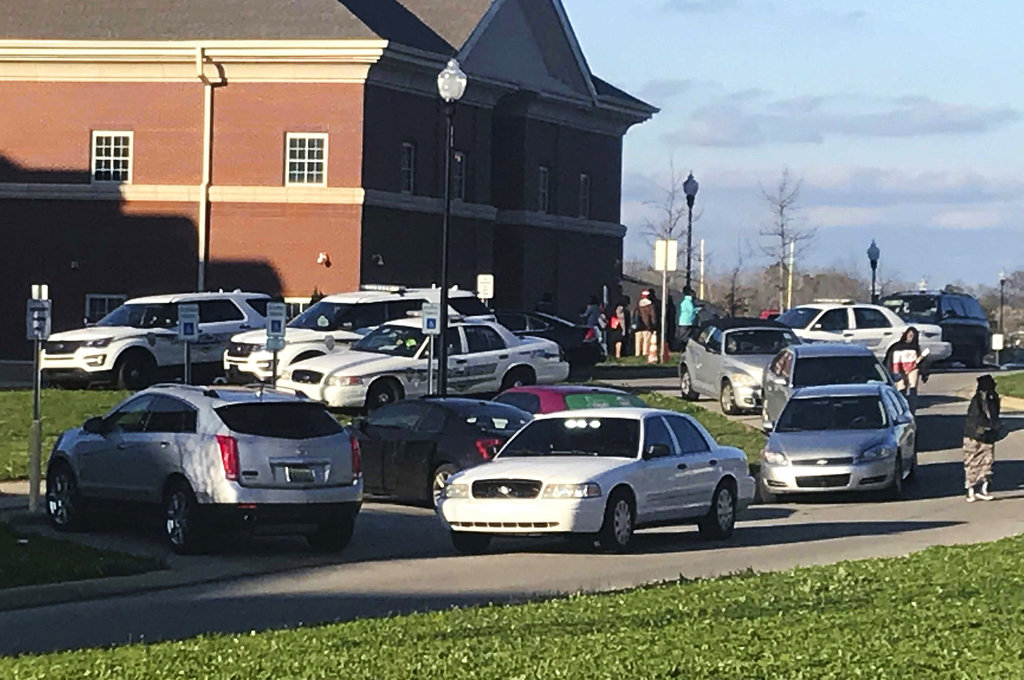 Authorities investigate the scene where a shooting occurred at Huffman High School. (Carol Robinson/AL.com via AP)