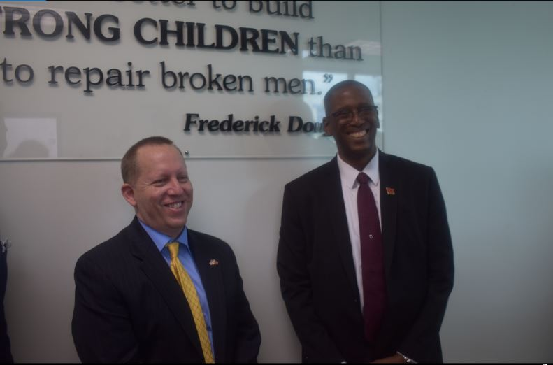 Chief Justice Ivor Archie pictured (right) at opening of New Children Court in St Clair on March 6.