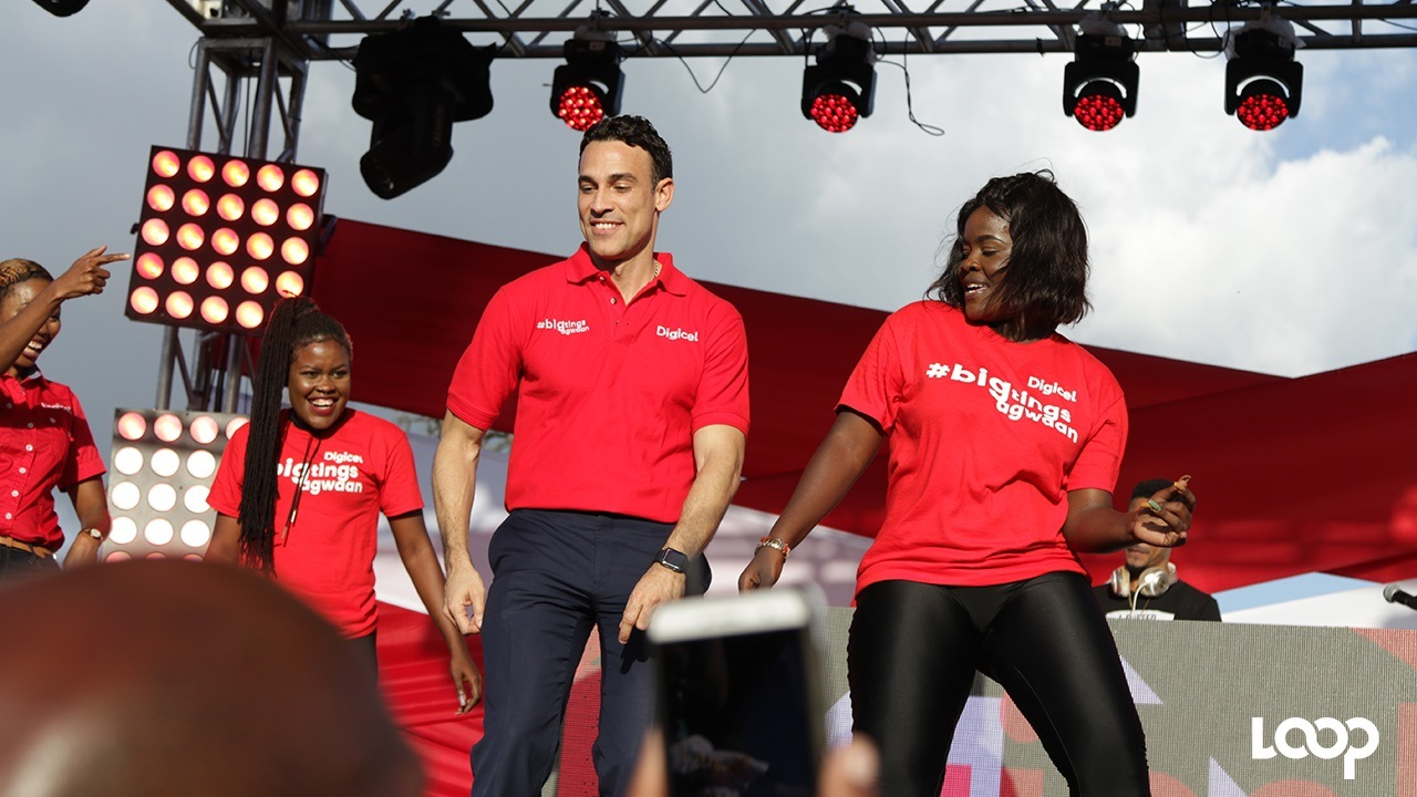 Digicel Jamaica CEO Justin Morin does the 'shoulder fling' dance at the communication leader's Destination Data launch last month.