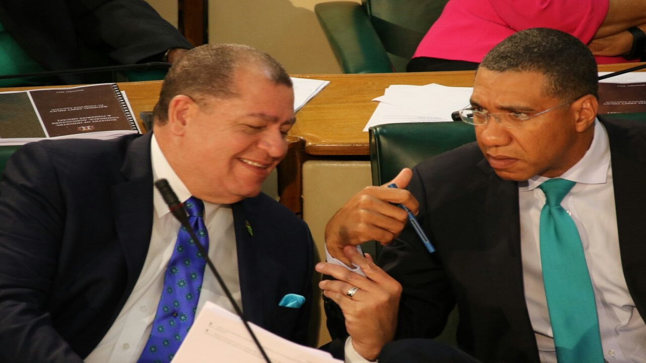 Finance Minister Audley Shaw (left) said a priority of the Government, following a decision not to impose new taxes for the fiscal year, is to improve tax compliance. Also pictured is Prime Minister Andrew Holness (right)