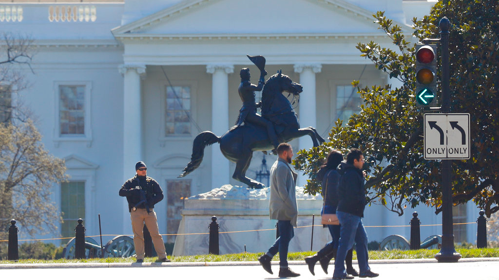 Law enforcement officer stands at the entrance to Lafayette Park across from the White House in Washington, after the area was closed to pedestrian traffic, Saturday, March 3, 2018. (AP Photo/Pablo Martinez Monsivais)