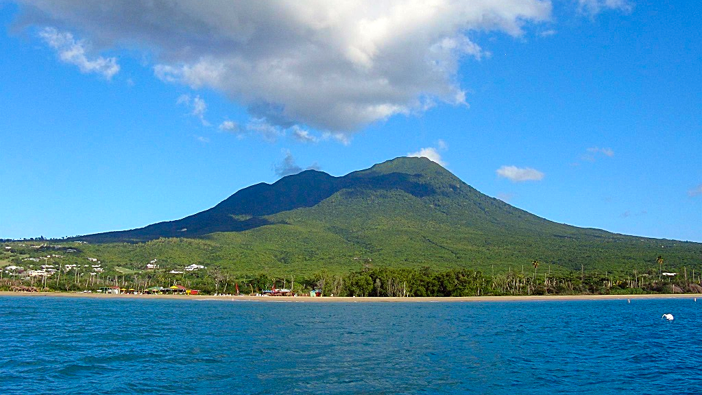 (Photo: Nevis Peak, a potentially active volcano on the island of Nevis, has no eruptions since prehistory, but there are active fumaroles and hot springs on the coastal slopes of the island, which represent low-level volcanic activity.