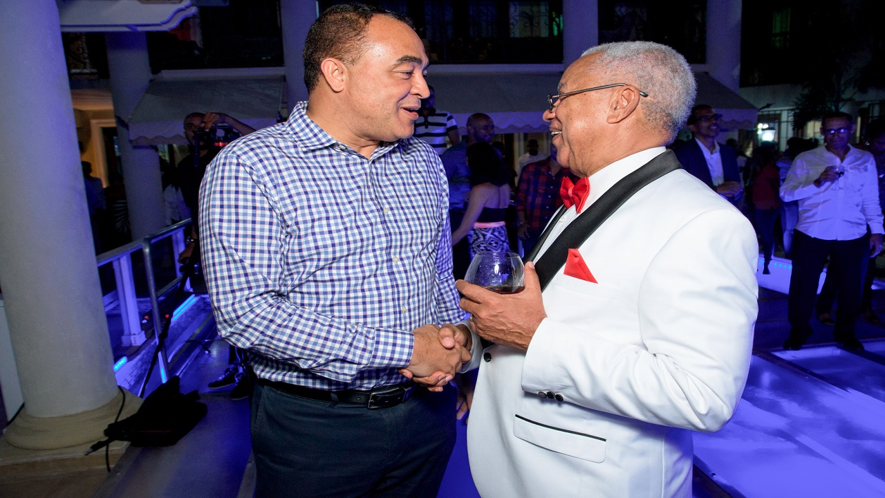 Minister of Health, Christopher Tufton and  CEO of Advanced Integrated System, Doug Halsall having a tête-à-tête at the company's 30th Anniversary function held at the residence of the CEO.