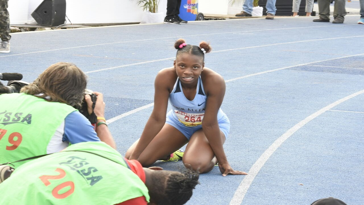 Kevona Davis of Edwin Allen cools down on the track after her record victory in the Girls' Class 2 200-metre final on Saturday at the 2018 ISSA/GraceKennedy Boys and Girls' Athletics Championships at the National Stadium. (PHOTO: Marlon Reid).