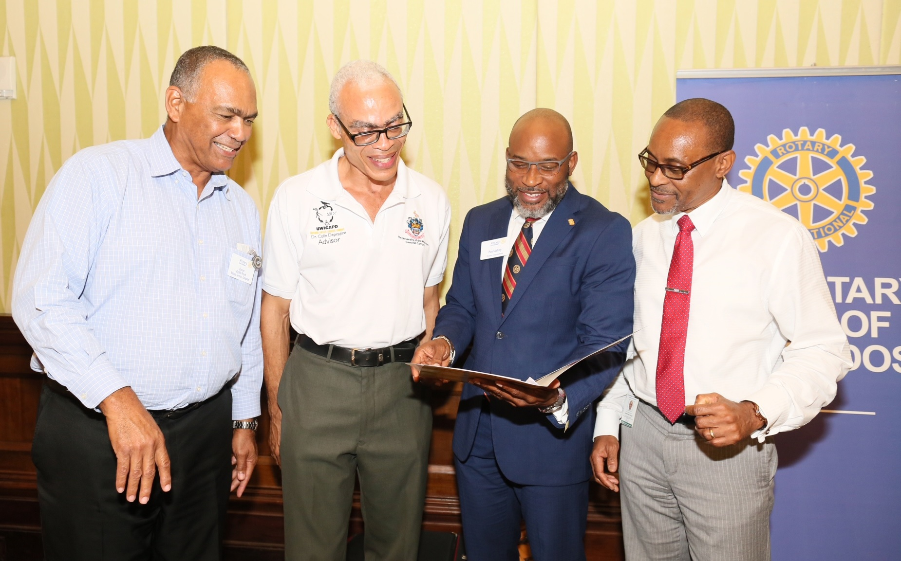 (L-R) International Business Machine (IBM) Sales Manager, Robin Ford; Dean of the faculty of Science and Technology at the University of the West Indies Cave Hill Campus, Dr Colin Depradine; President of Rotary Club of Barbados, Paul Ashby; Director of The National Council for Science and Technology (NCST) (Ag.),  Charles Cyrus.