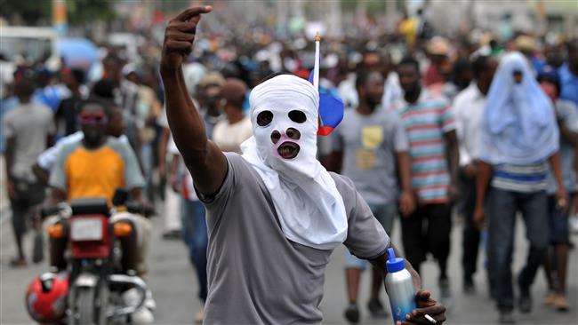 Aux Gonaïves, des « bandits »  sèment la terreur. Photo: AFP