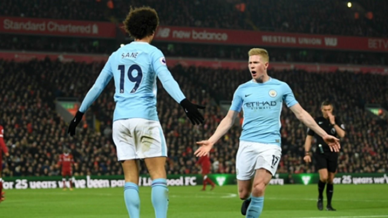 Kevin De Bruyne (right) celebrates with Leroy Sane at Anfield.