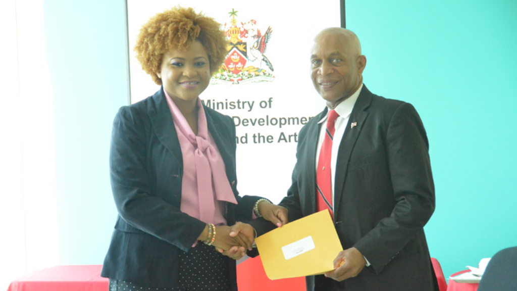 File: Culture Minister Nyan Gadsby-Dolly presents NCC's Chairman Mr. Colin Lucas with his instrument of appointment in 2017.