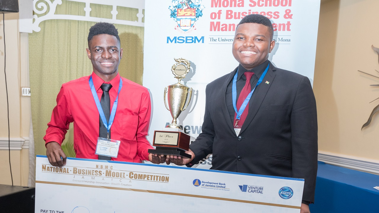 The 2018 Winners of the National Business Model Competition and UWI students Kevonne Martin (left), VP of Marketing and Operations, Queritel and Shani Bennett, CEO and Founder, Queritel.
