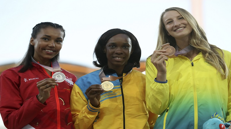 Women's high jump gold medalist Saint Lucia's Levern Spencer, centre, stands with silver medalist England's Morgan Lake, left, and bronze medalist Australia's Nicola McDermott at Carrara Stadium during the 2018 Commonwealth Games on the Gold Coast, Australia, Saturday, April 14, 2018. (AP Photo/Mark Schiefelbein)