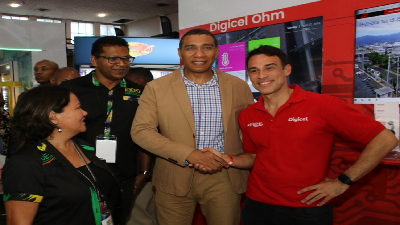 Prime Minister Andrew Holness (centre) shares a moment with Digicel Jamaica CEO Justin Morin (right) and Richard Pandohie (2nd left) Deputy President of the Jamaica Manufacturers' Association and Michelle Chong (left), President of the Jamaica Exporters' Association on the final day of Expo Jamaica 2018.