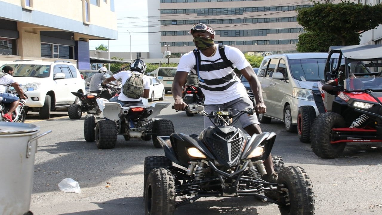 Usain Bolt was spotted on his quad enjoying the carnival road march festivities. (PHOTOS: Llewellyn Wynter)