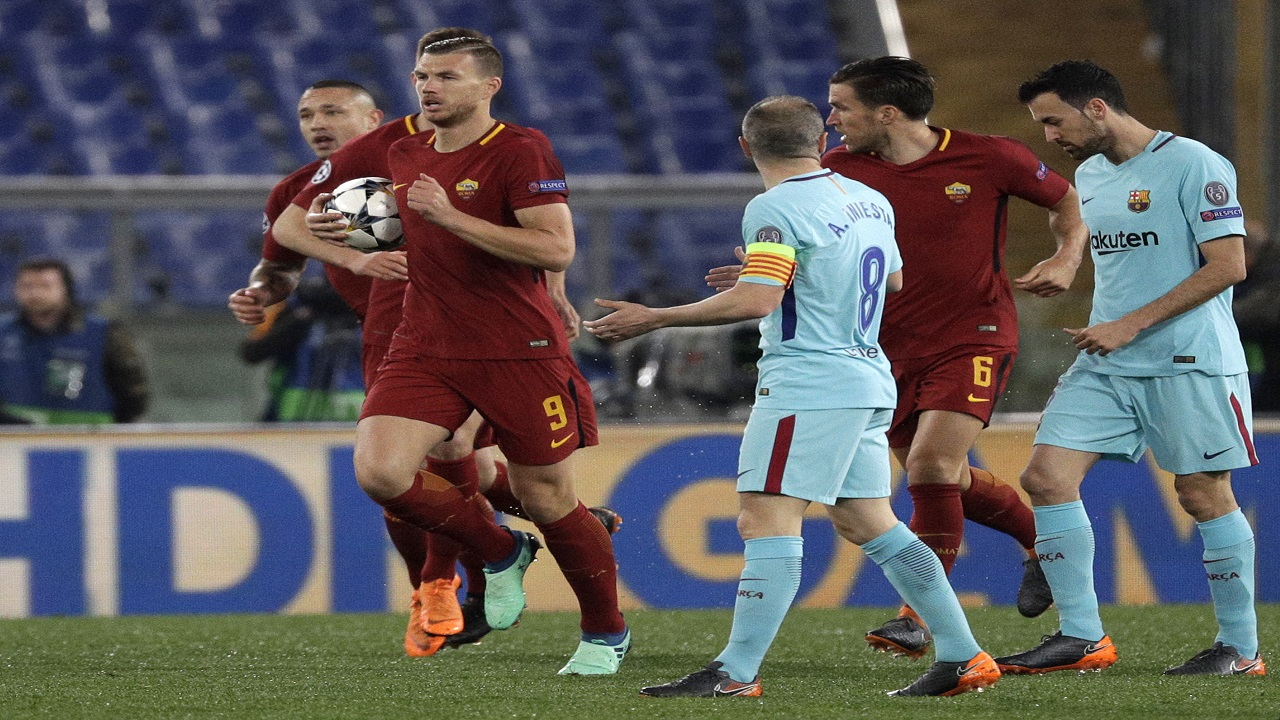 Roma's Edin Dzeko runs with the ball after scoring his side's first goal during the Champions League quarterfinal second leg match against Barcelona, at Rome's Olympic Stadium, Tuesday, April 10, 2018.